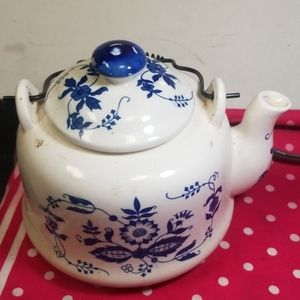 Vintage porcelain tea pot with metal